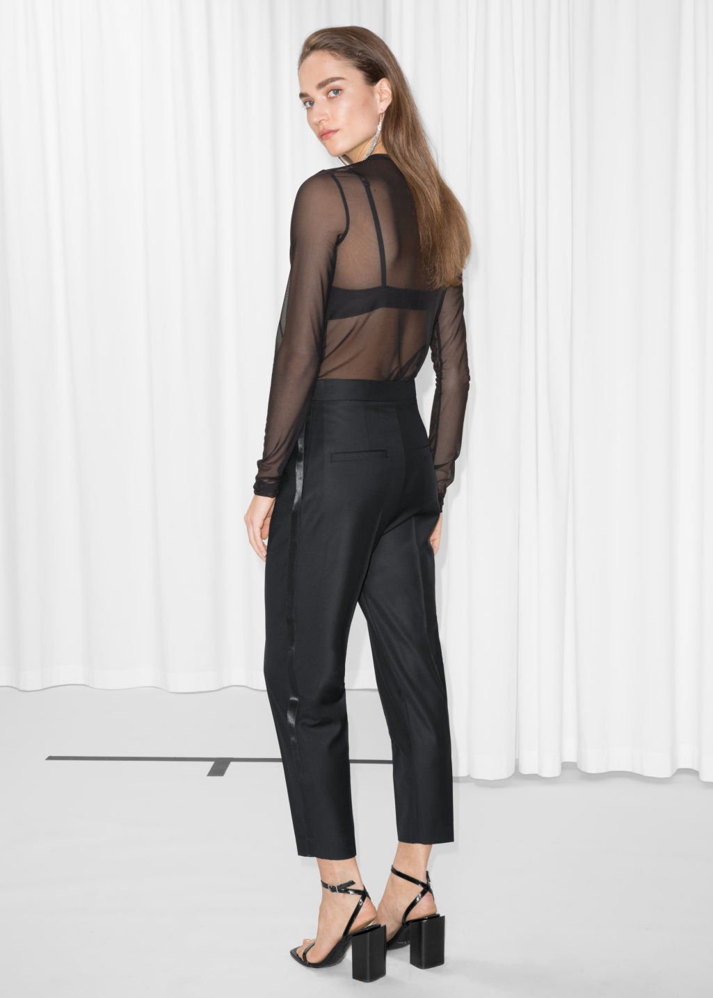 Model back image of Stories side satin panel trousers in black