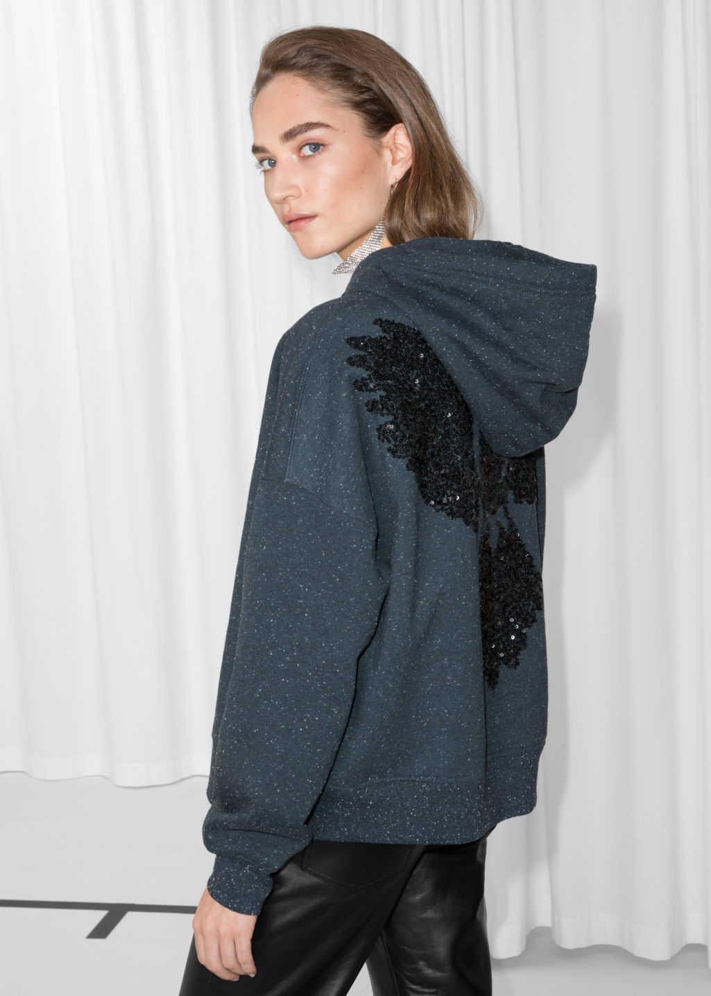 Model front image of Stories bird sequin hoodie in blue