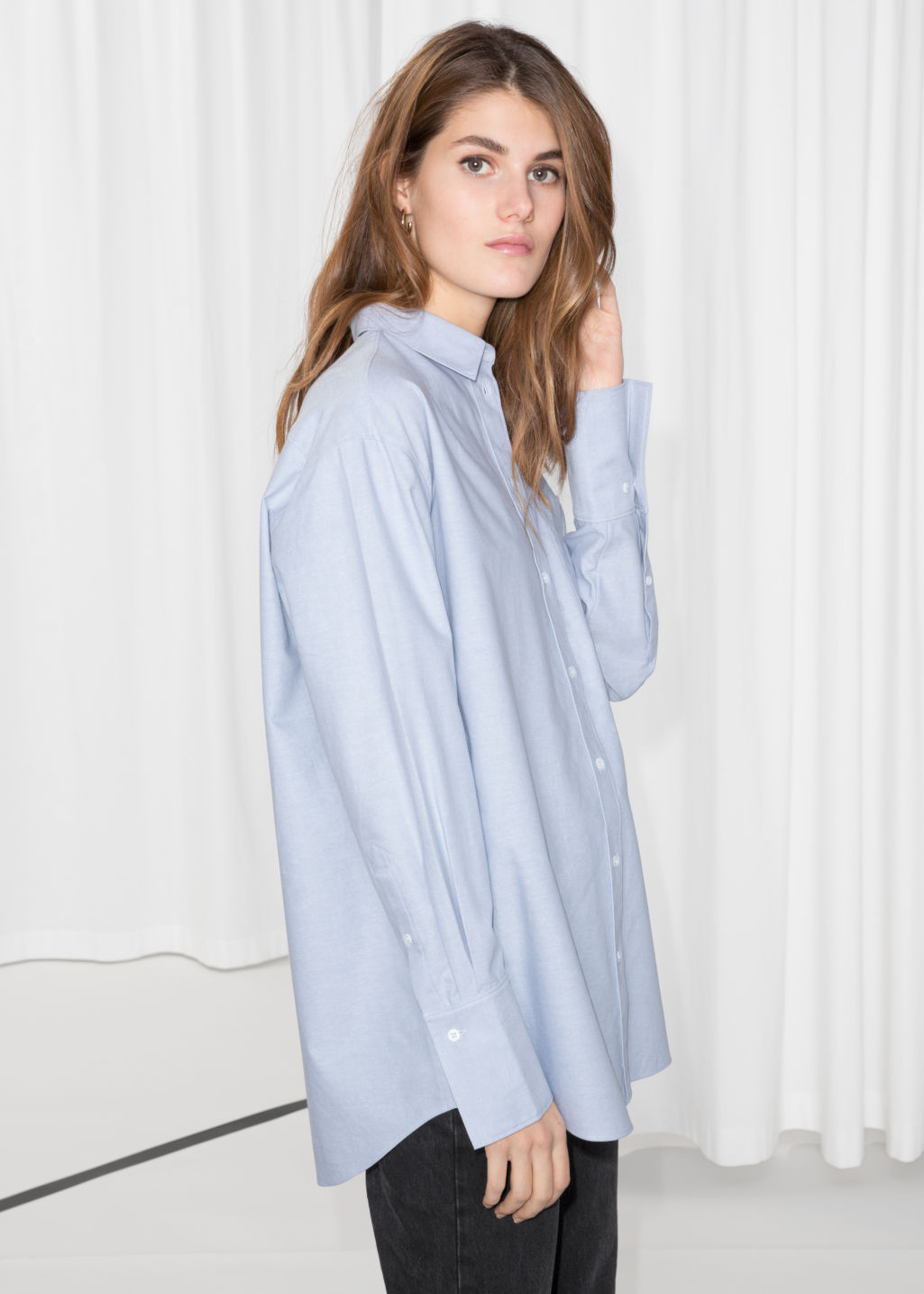 Model front image of Stories oversized button down shirt in blue