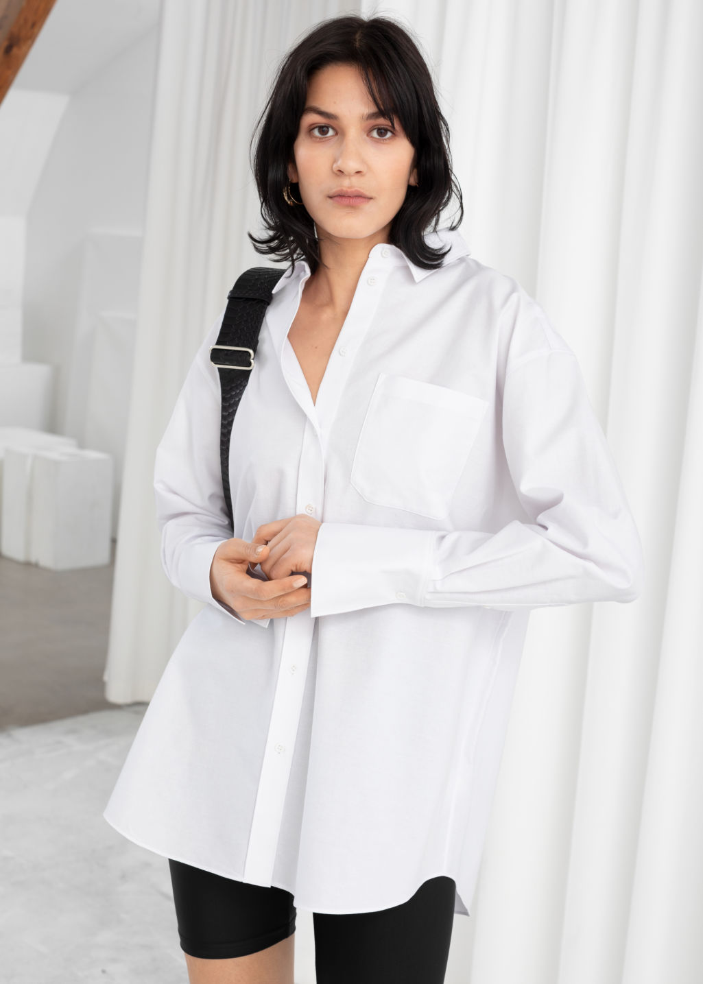 Model front image of Stories oversized button down shirt in white