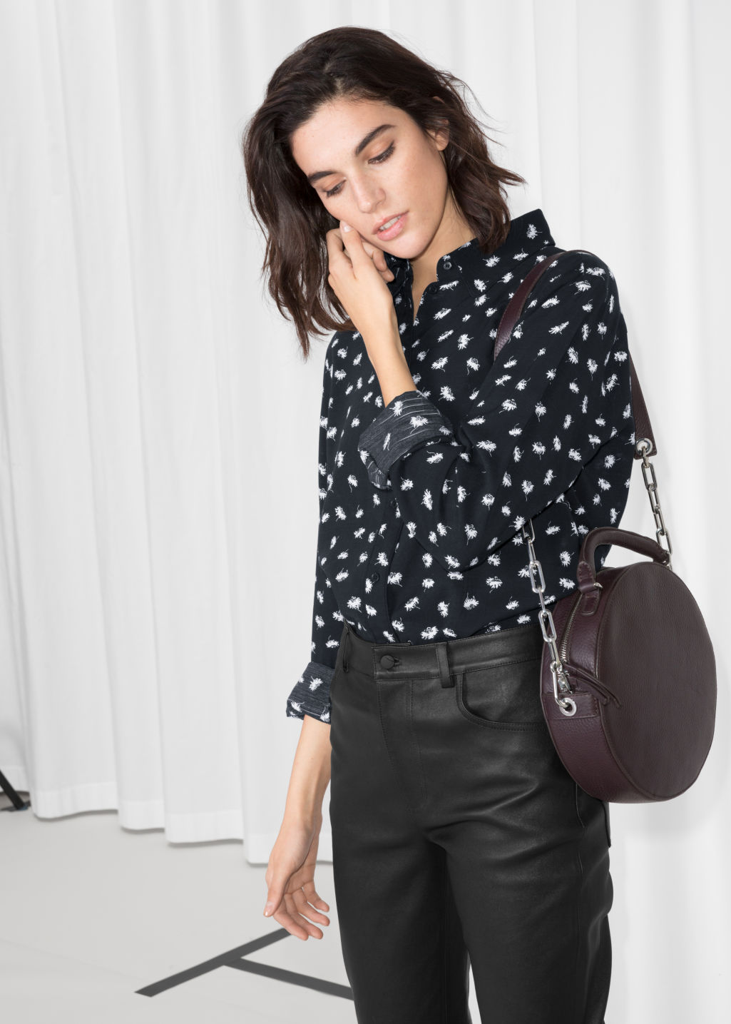 Model front image of Stories button down shirt in black