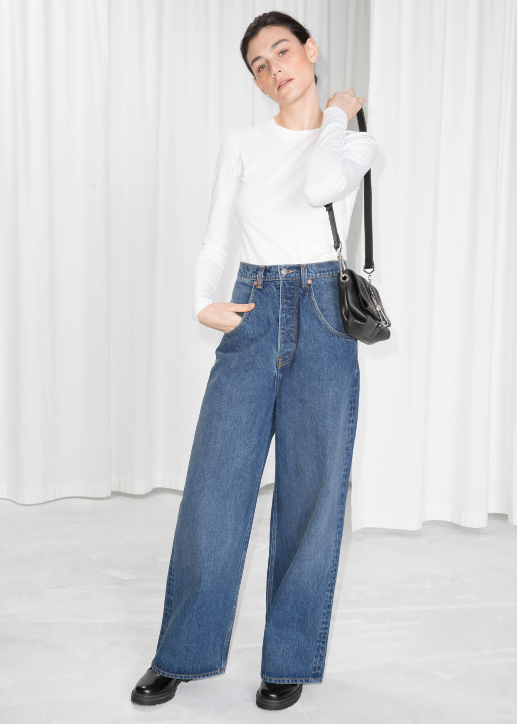 Model front image of Stories wide high waisted jeans  in blue