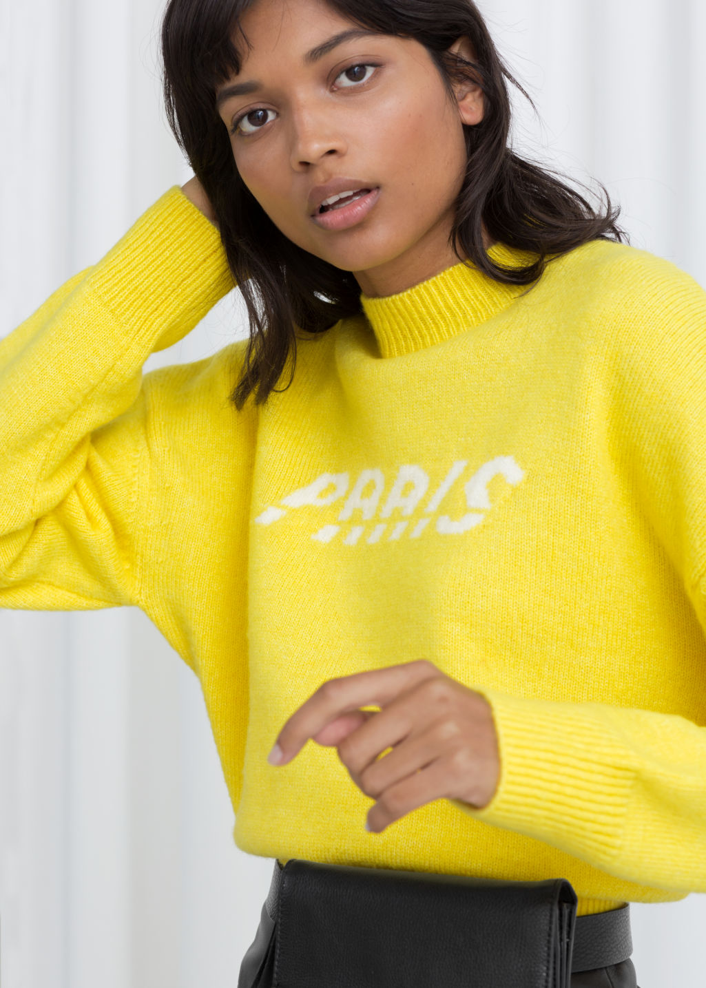 Model front image of Stories paris sweater in yellow