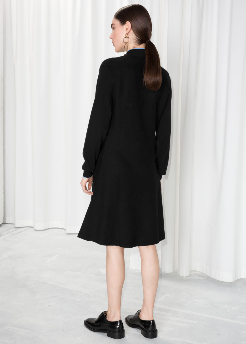 Model back image of Stories micro knit fit and flare dress in black