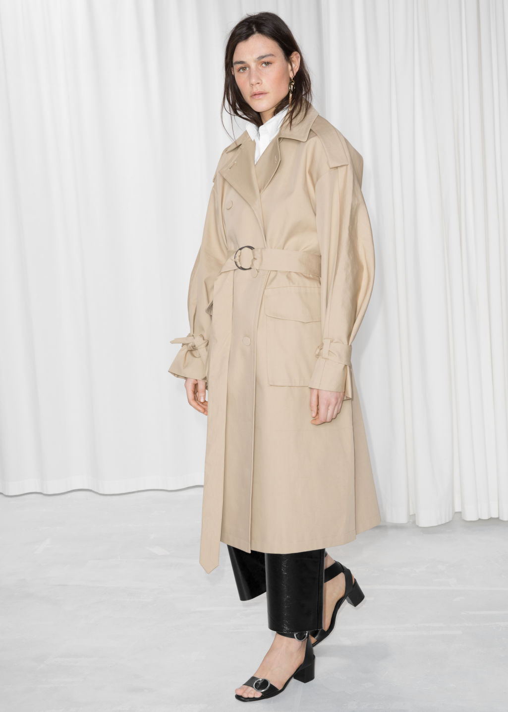 Model front image of Stories oversized trench coat in beige