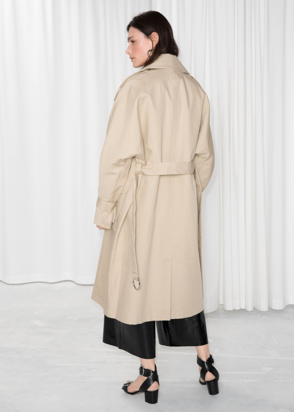 Model back image of Stories oversized trench coat in beige
