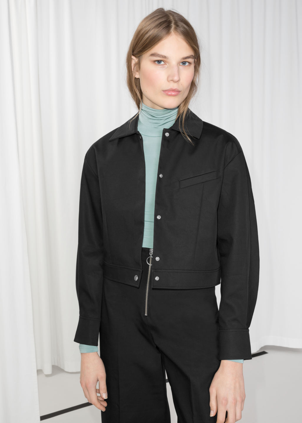 Model front image of Stories cropped jacket in black