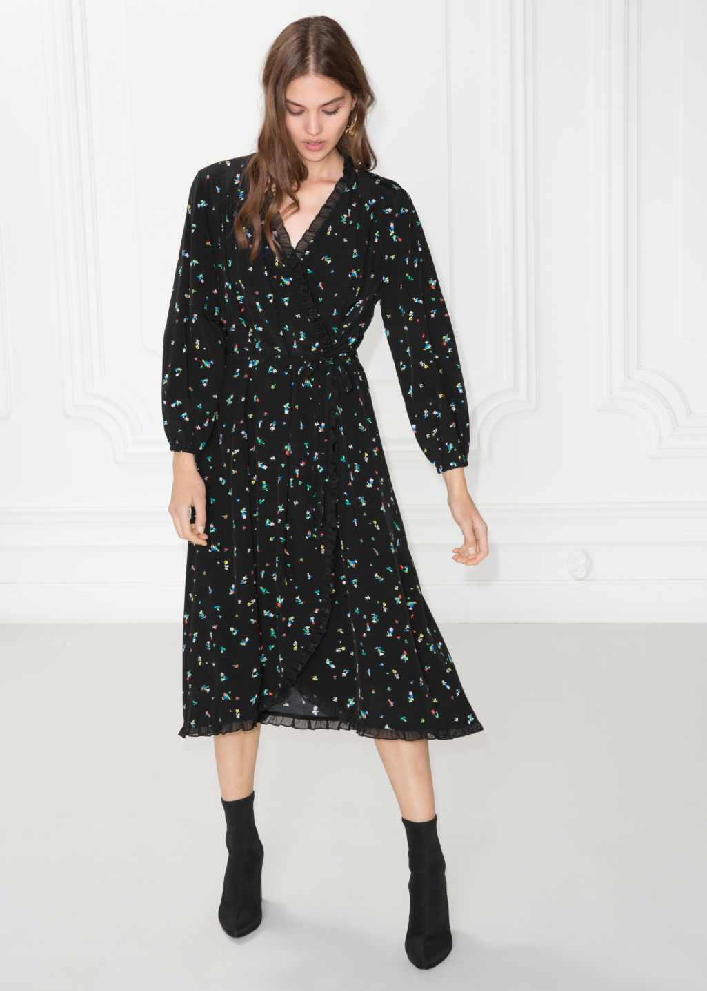 Model front image of Stories ruffled wrap dress in black
