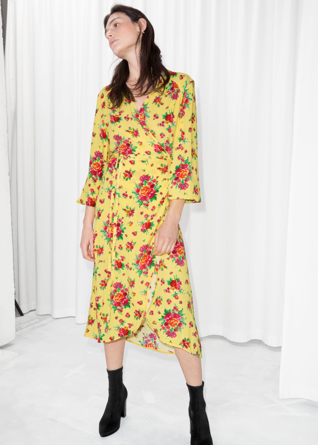 Model front image of Stories ruffled wrap dress in yellow