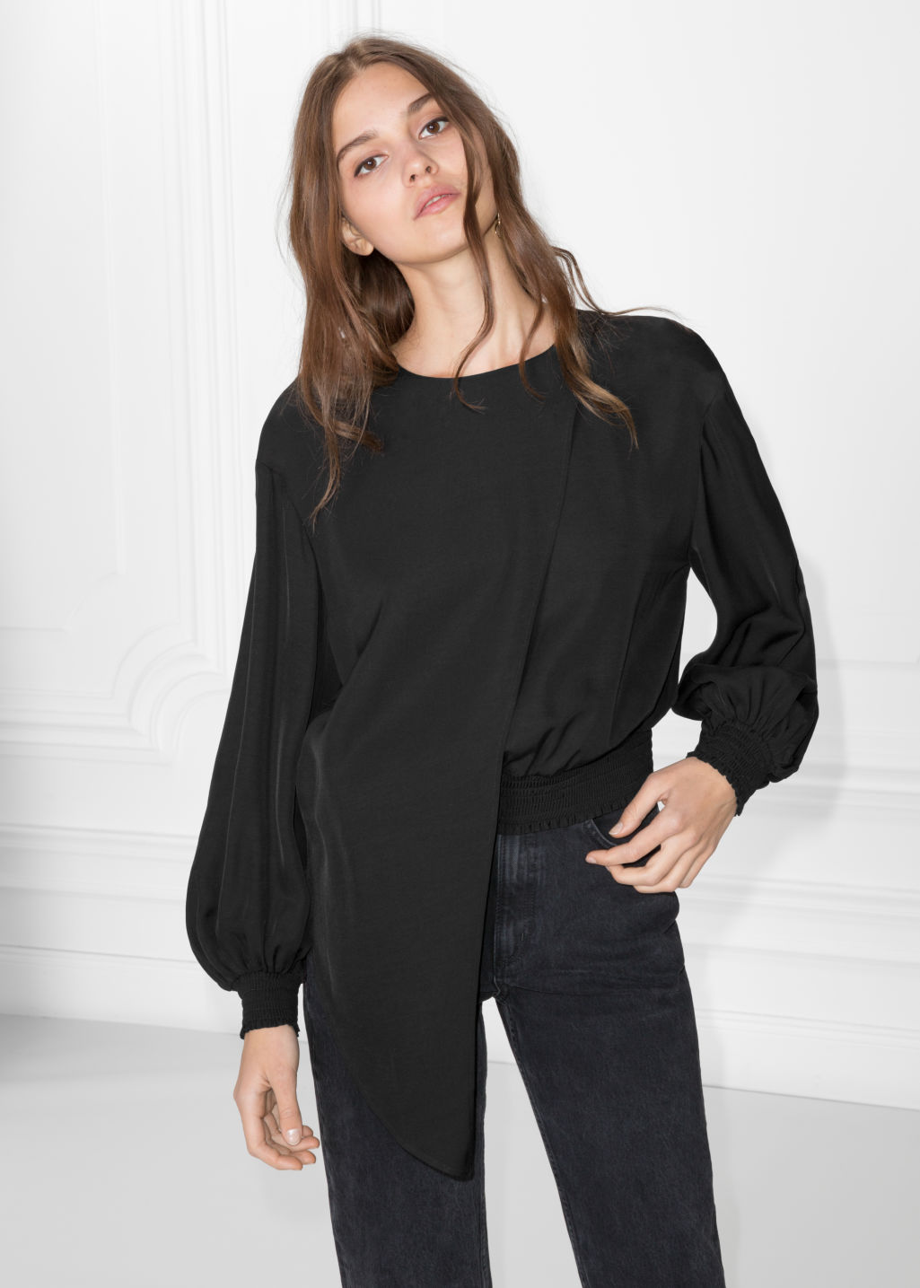 Model front image of Stories asymmetrical blouse in black