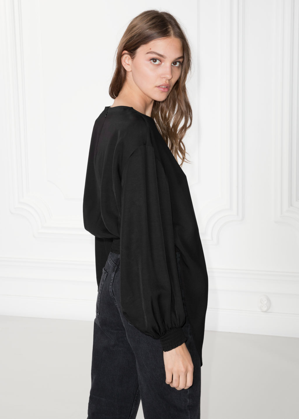 Model back image of Stories asymmetrical blouse in black