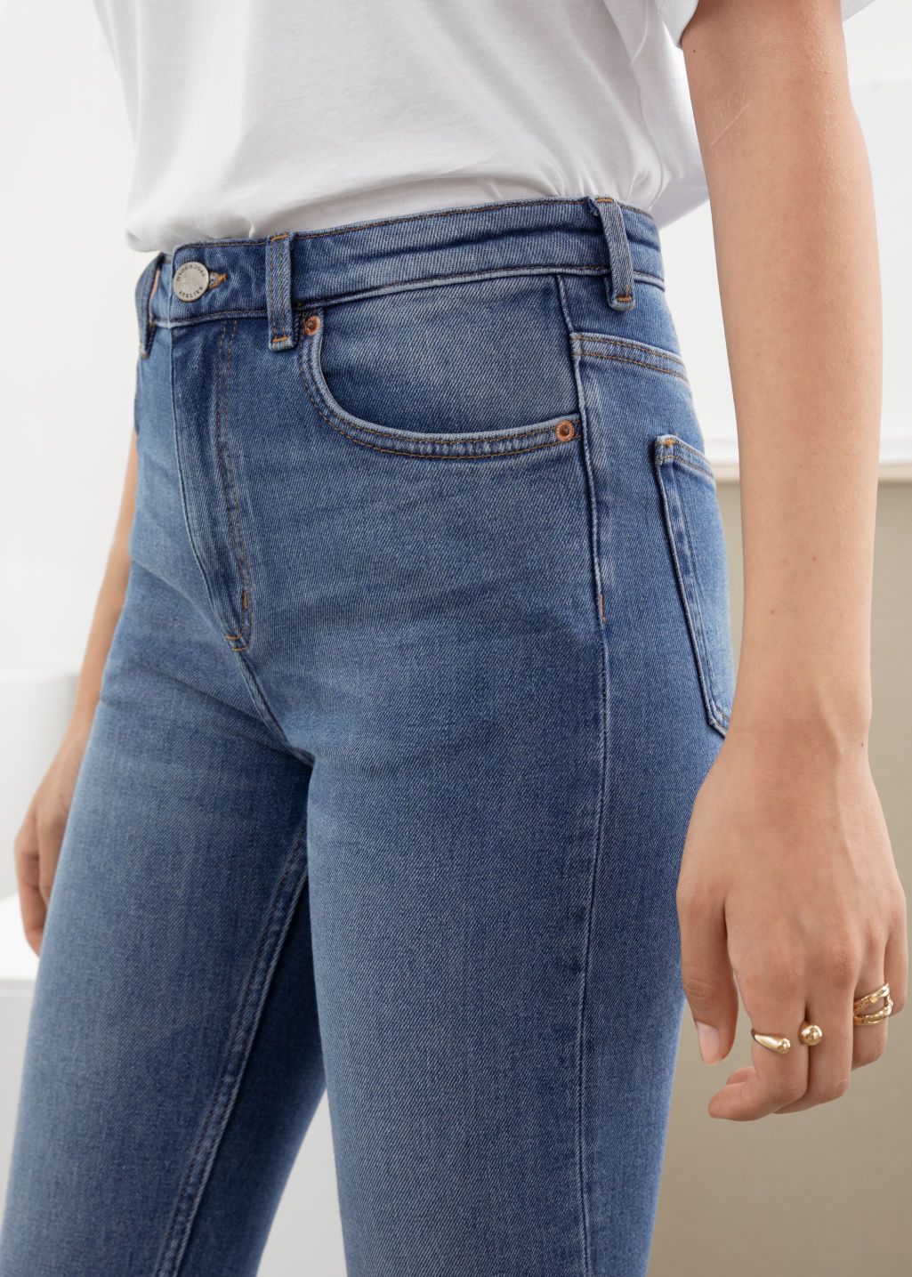 Model back image of Stories straight slim fit jeans in blue