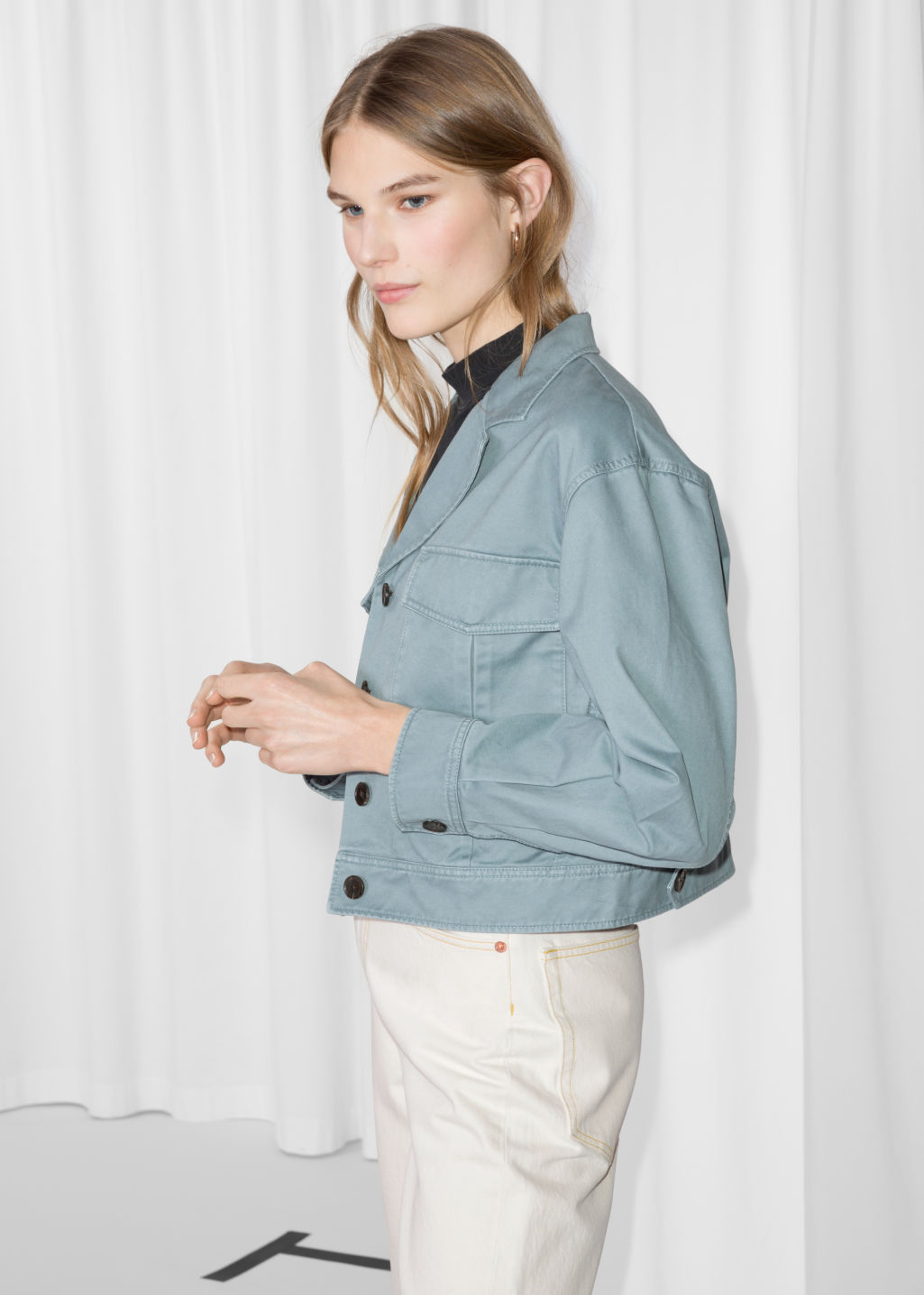 Model front image of Stories cropped utilitarian jacket in turquoise