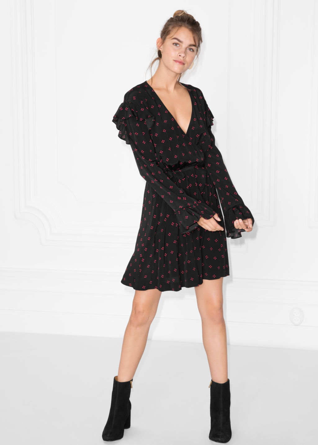 Model front image of Stories frill wrap dress in black