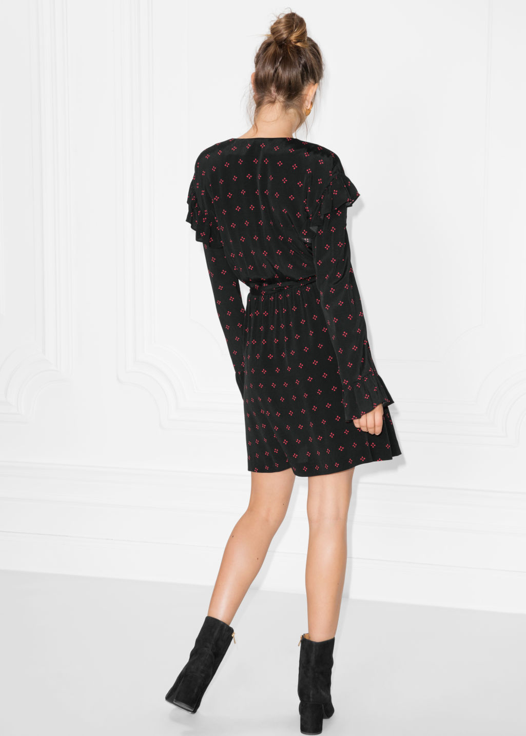 Model back image of Stories frill wrap dress in black