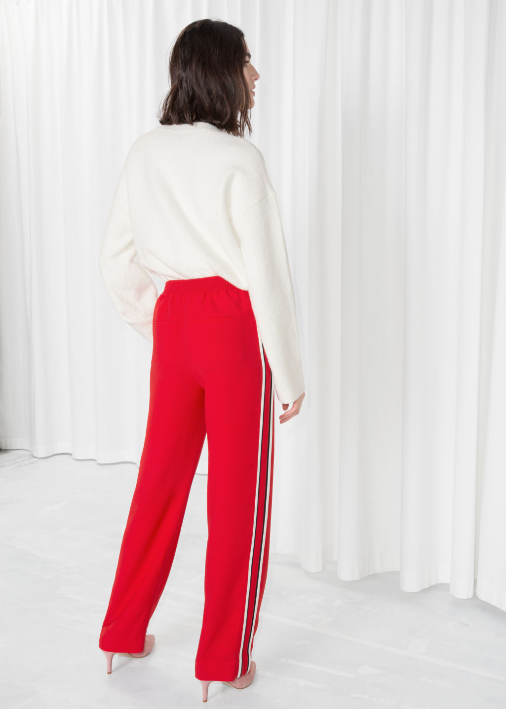 Model back image of Stories racer stripe trousers in red