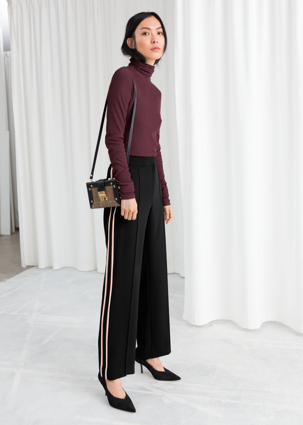 Model front image of Stories racer stripe trousers in black