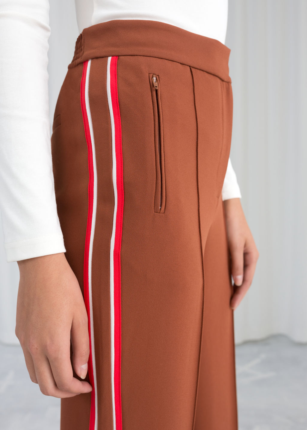 Model back image of Stories racer stripe trousers in brown