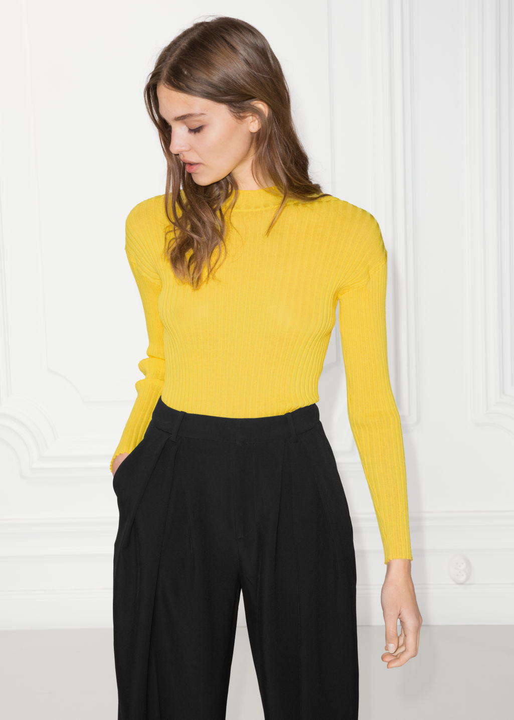 Model front image of Stories fitted mock neck top  in yellow