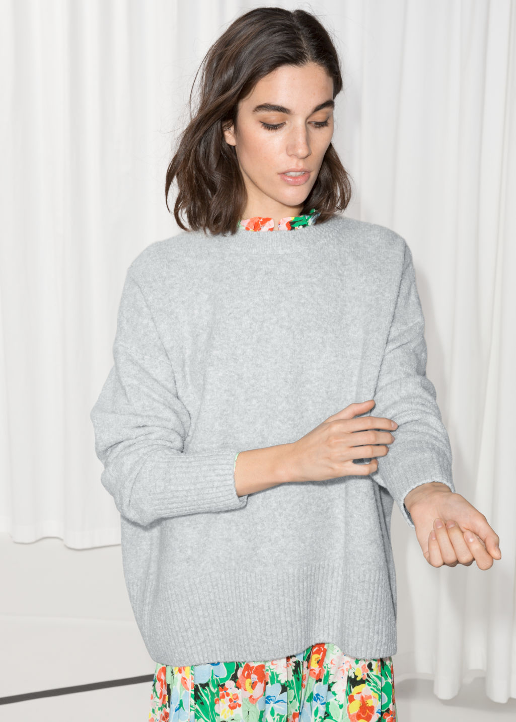 Model front image of Stories boxy knit sweater in grey