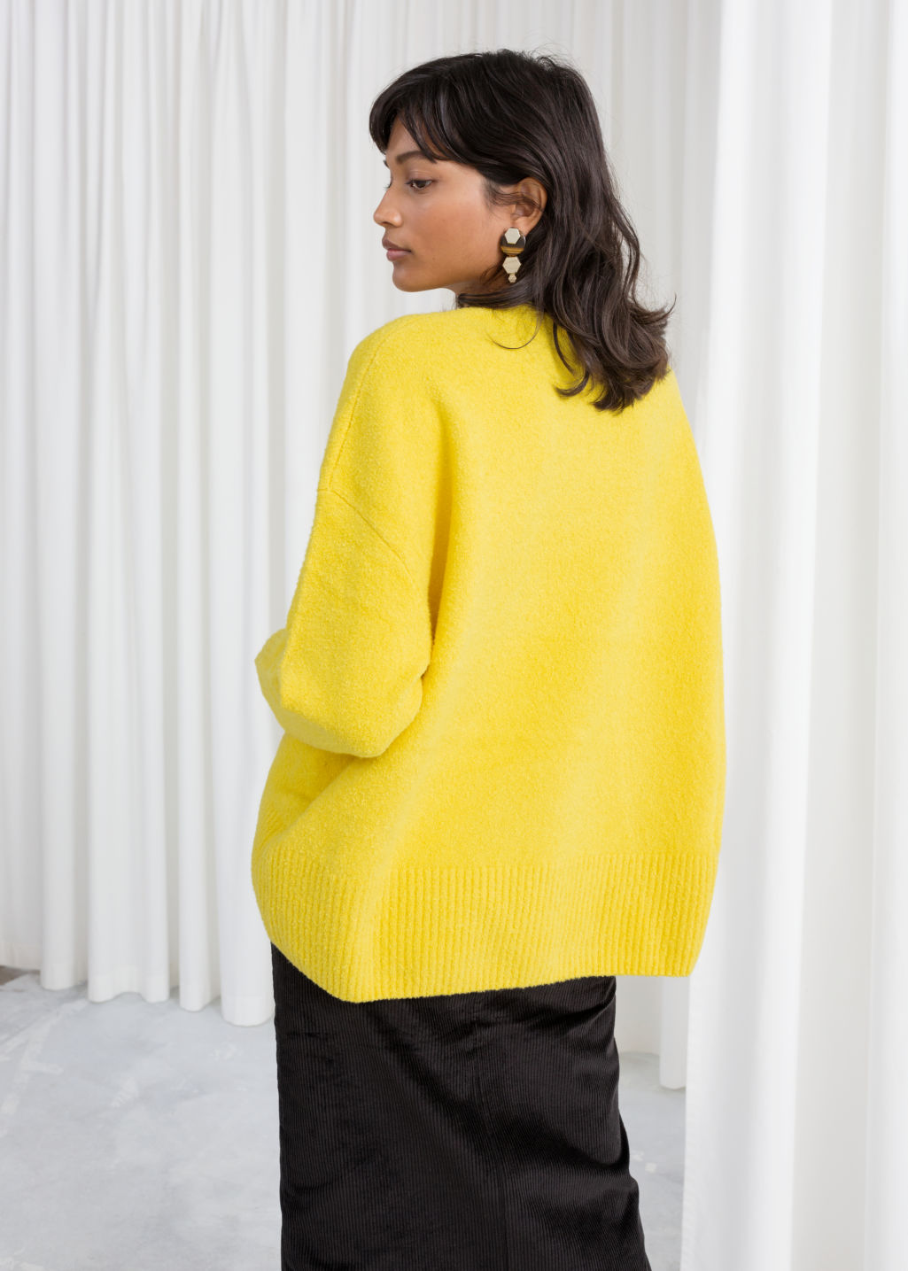 Model back image of Stories boxy knit sweater in yellow