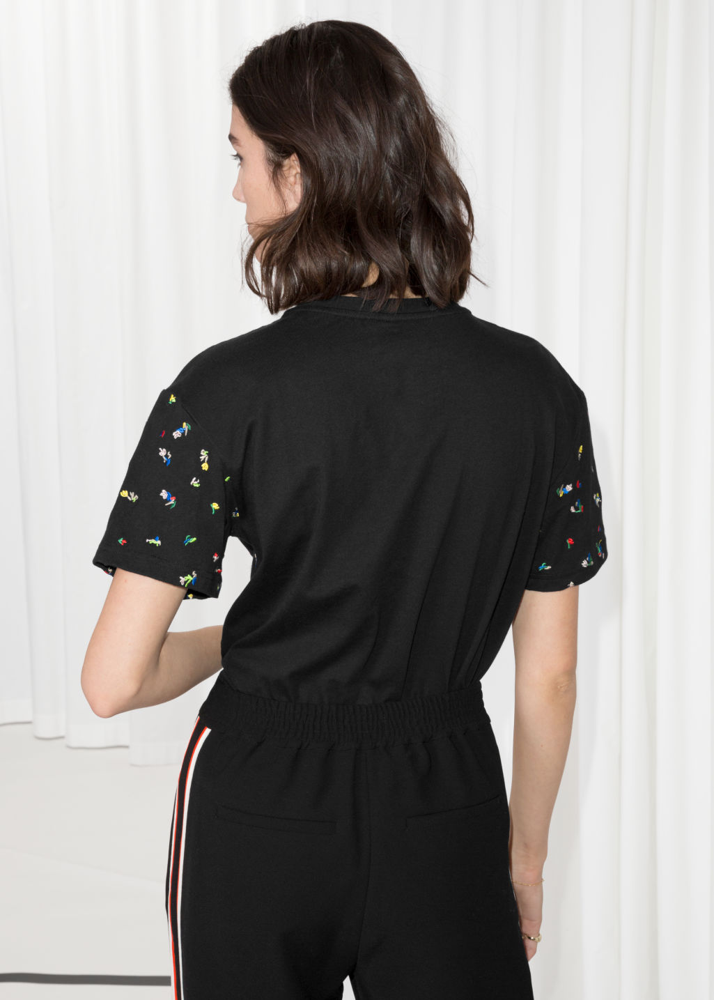 Model back image of Stories embroidered crewneck t-shirt in black
