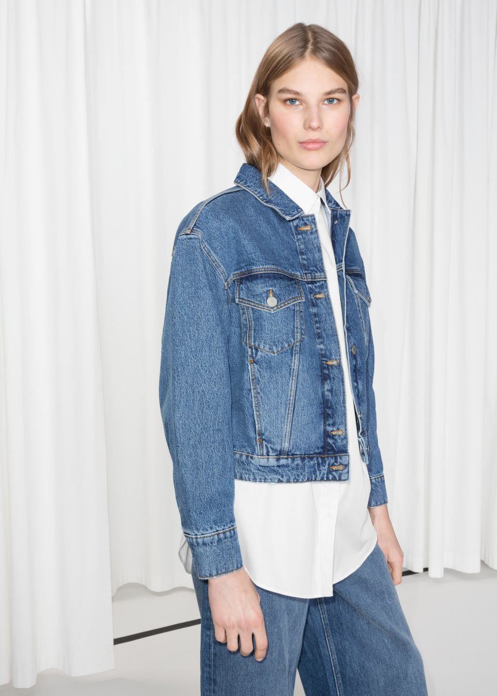 Model front image of Stories cropped denim jacket in blue