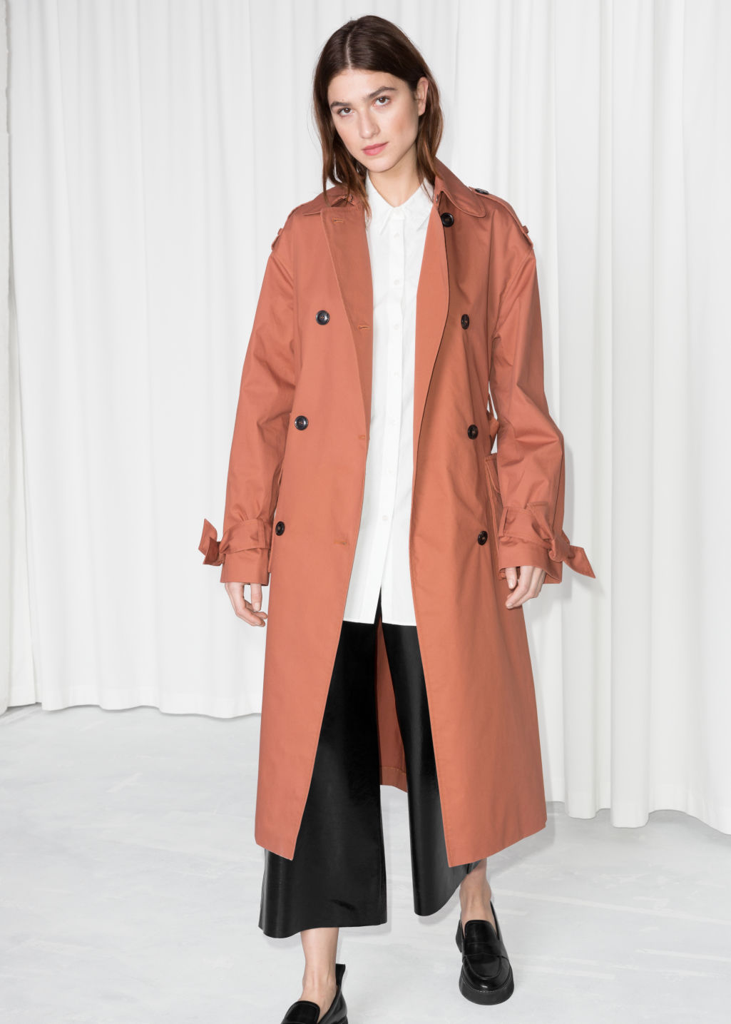 Model front image of Stories belted oversized trenchcoat in orange