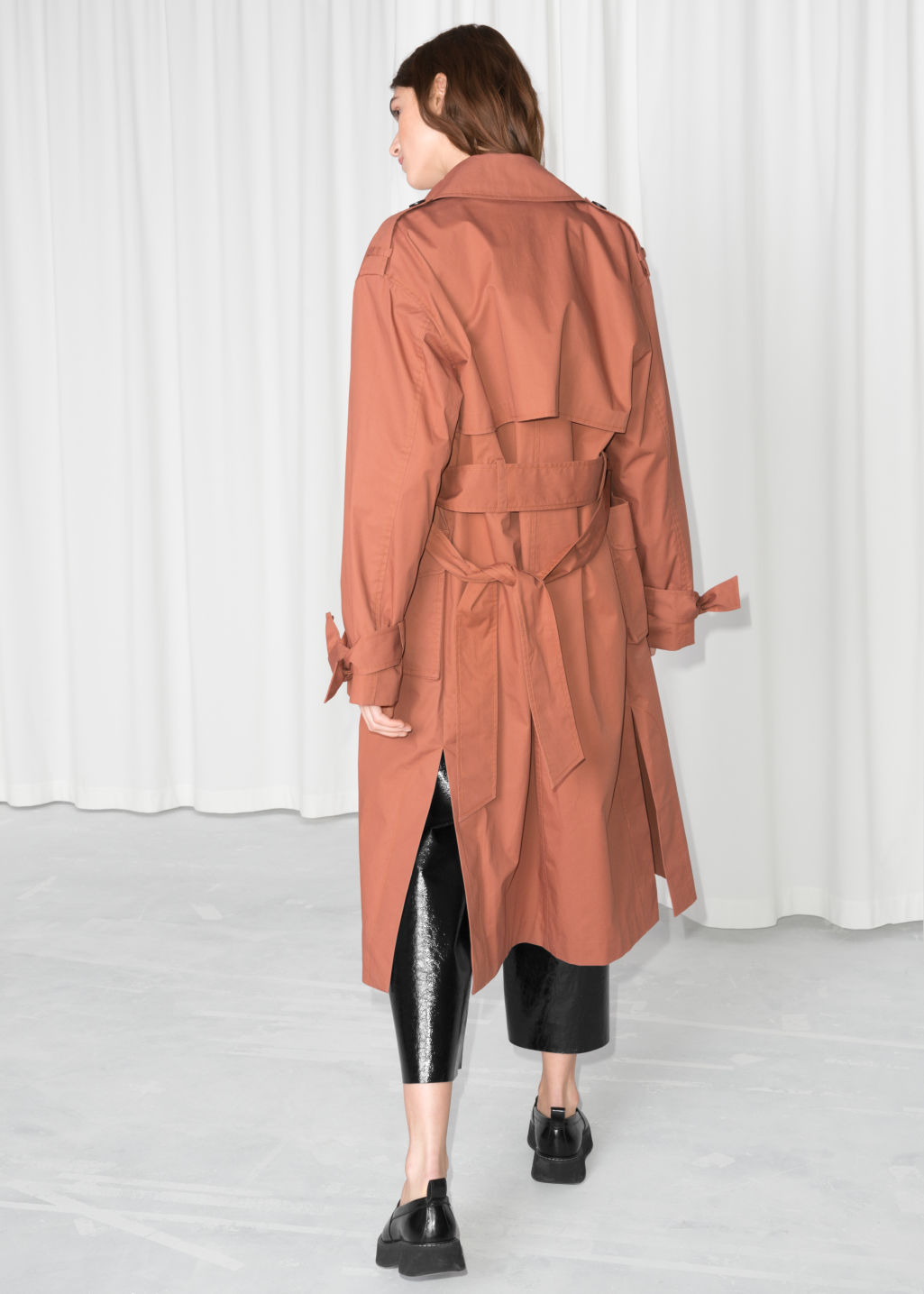 Model back image of Stories belted oversized trenchcoat in orange