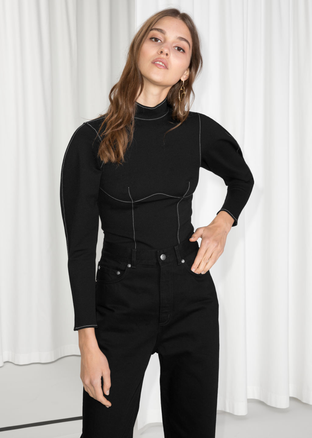 Model front image of Stories slim sweater in black