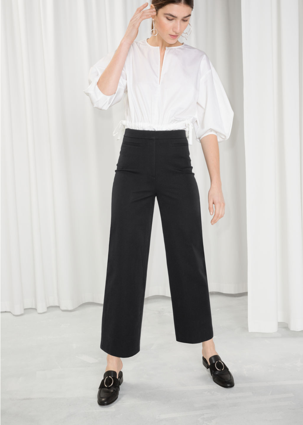 Model front image of Stories cotton blend chinos  in black