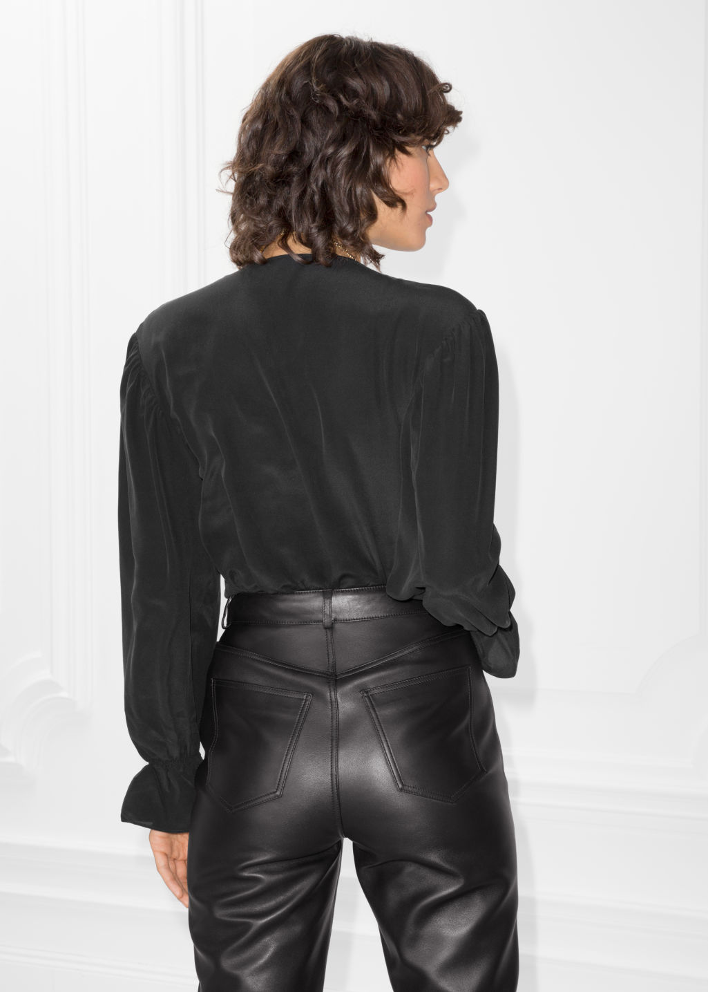 Model back image of Stories dropped shoulder silk blouse in black