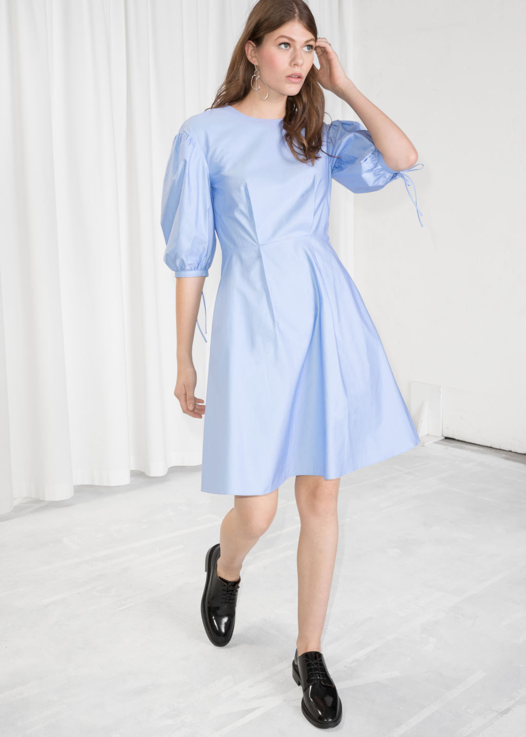 Model front image of Stories balloon sleeve skater dress in blue