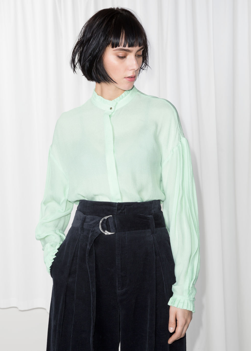 Model front image of Stories sheer pleated blouse  in green