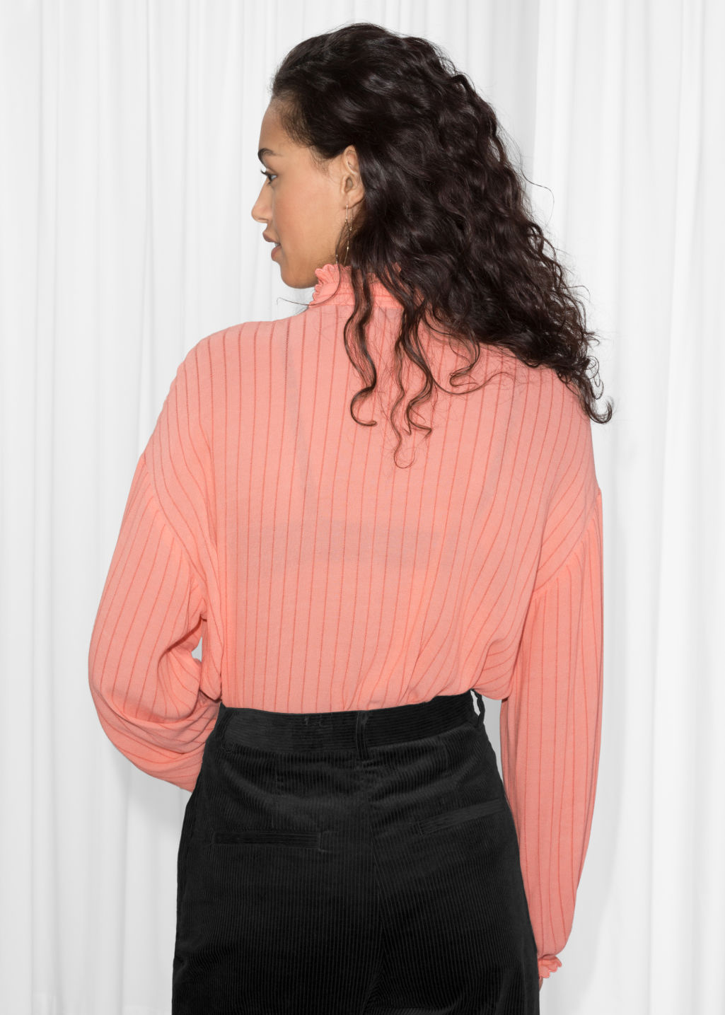 Model back image of Stories scalloped ruffle blouse in orange