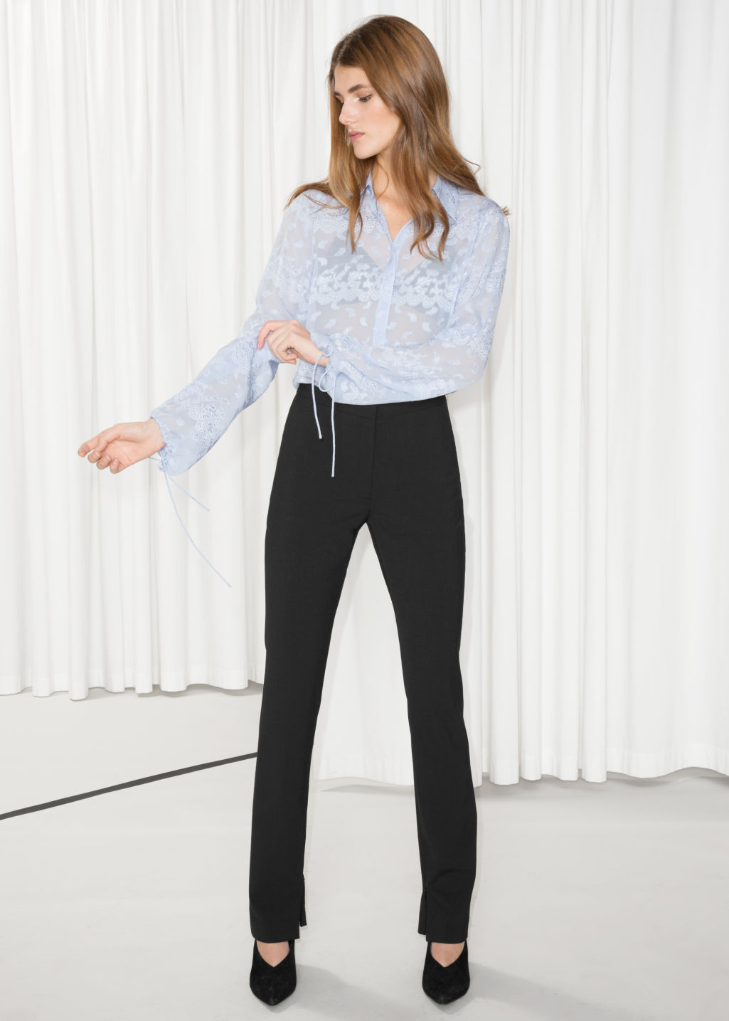 Model front image of Stories skinny flare trousers in black