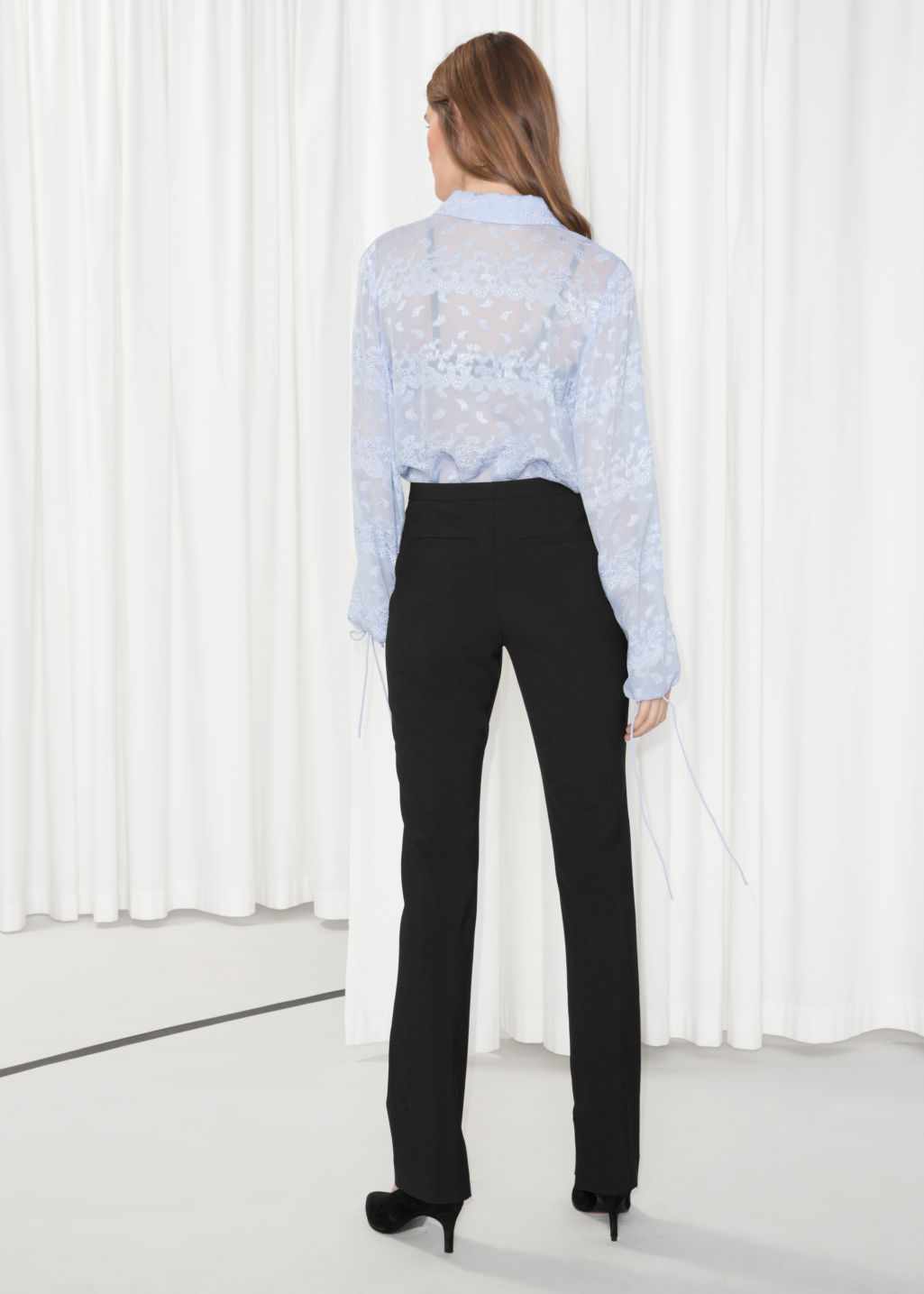 Model back image of Stories skinny flare trousers in black