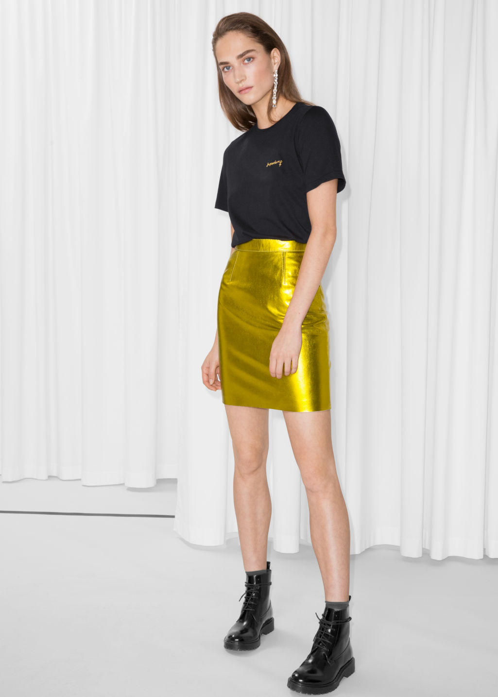 Model front image of Stories leather skirt in yellow