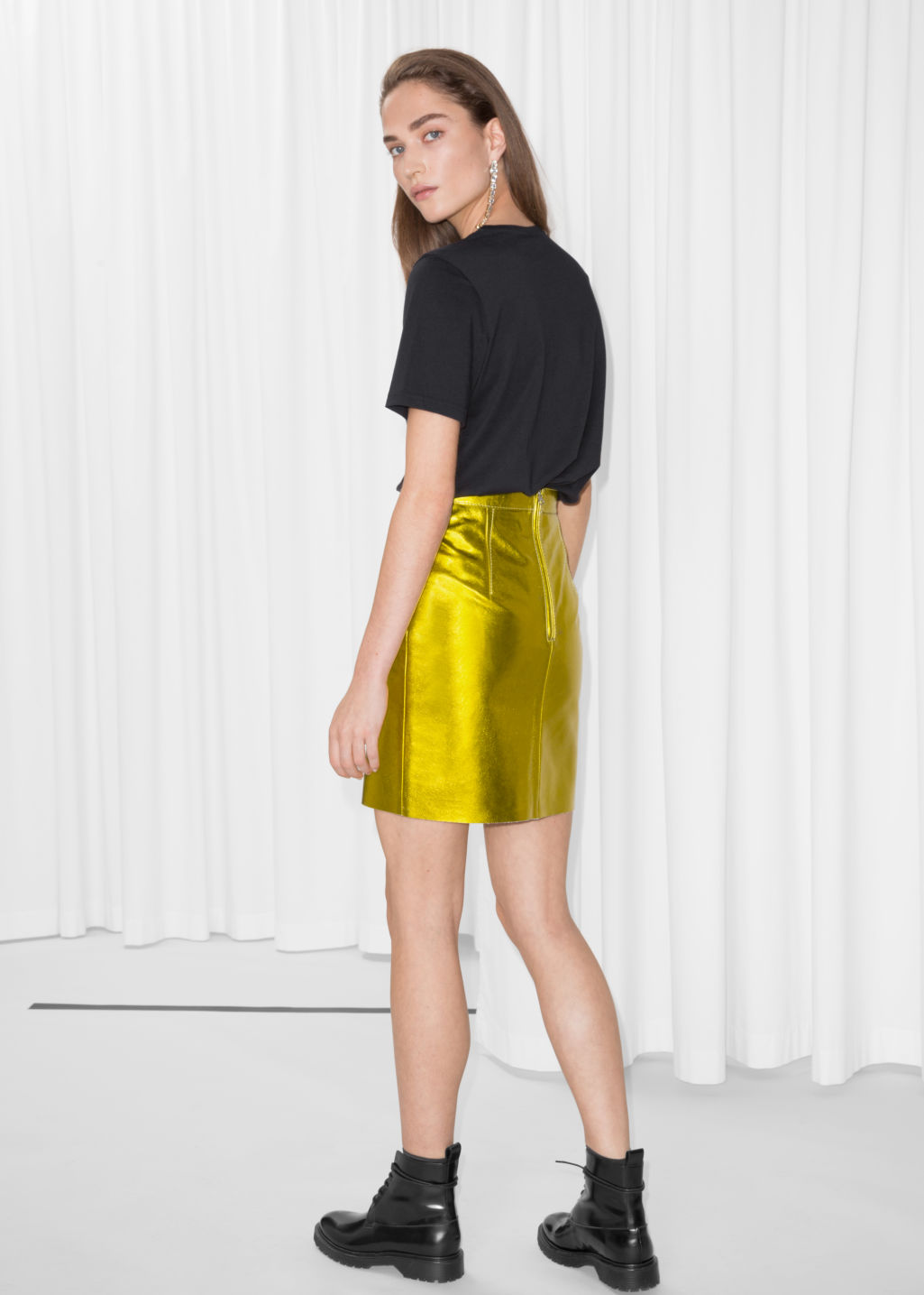 Model back image of Stories leather skirt in yellow