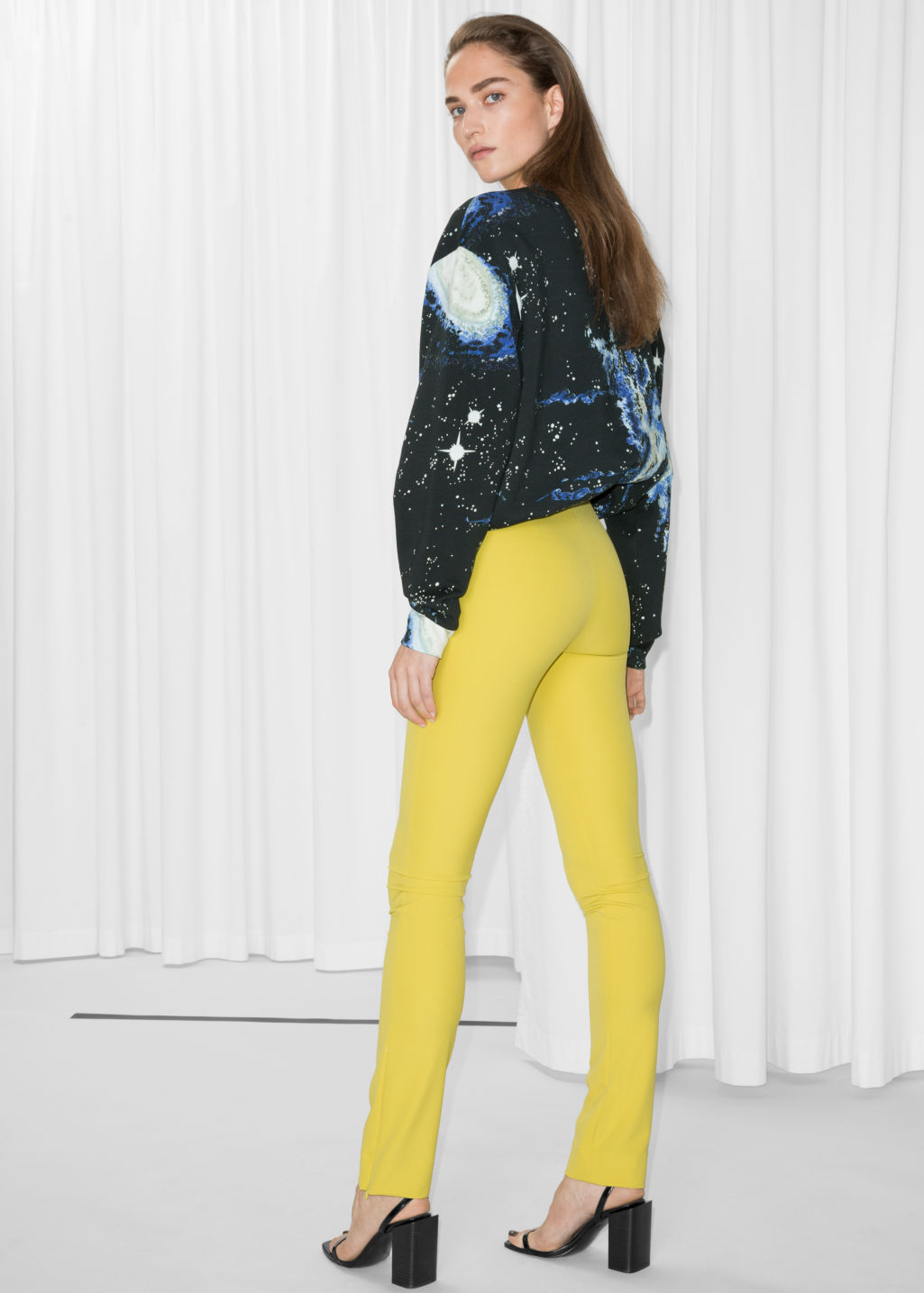 Model back image of Stories skinny trousers in yellow