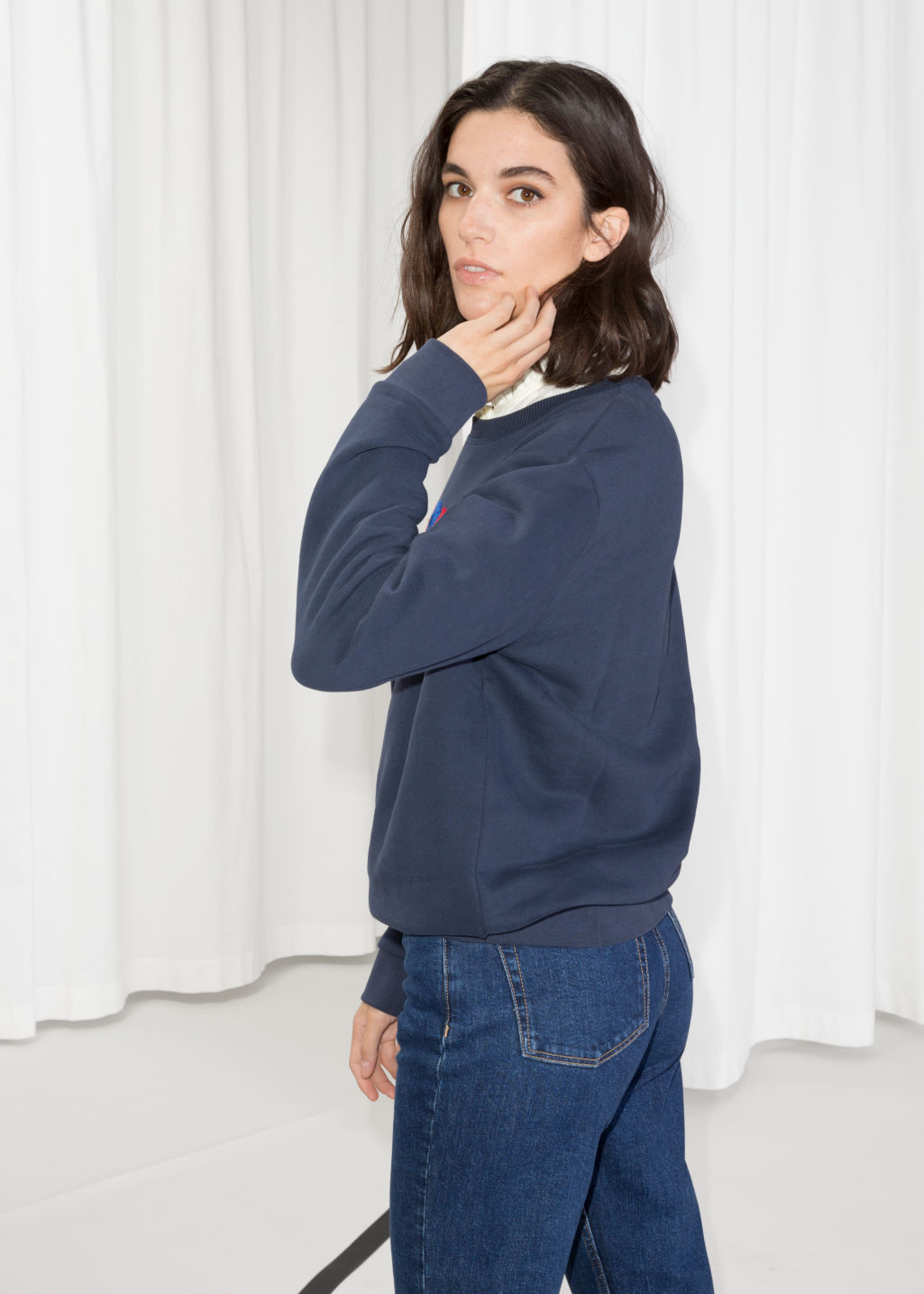 Model back image of Stories embroidered fleece sweatshirt in blue
