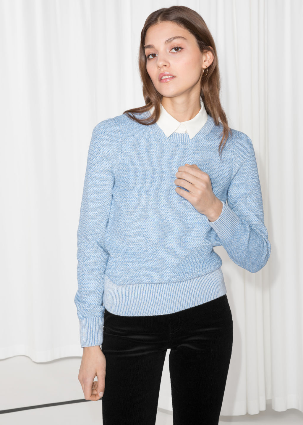 Model front image of Stories shoulder puff sweater in blue