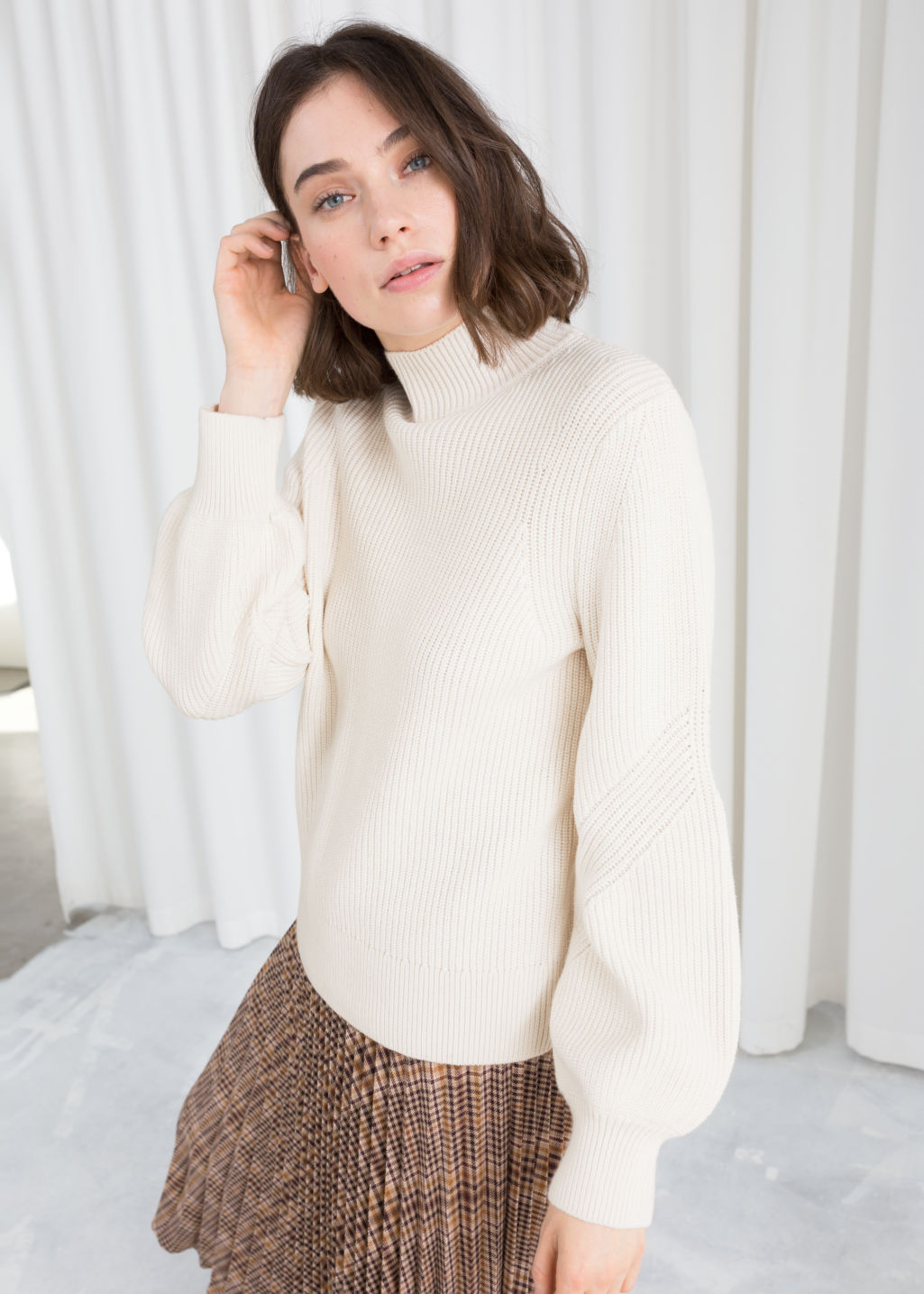 Model front image of Stories puffy sleeve sweater in white