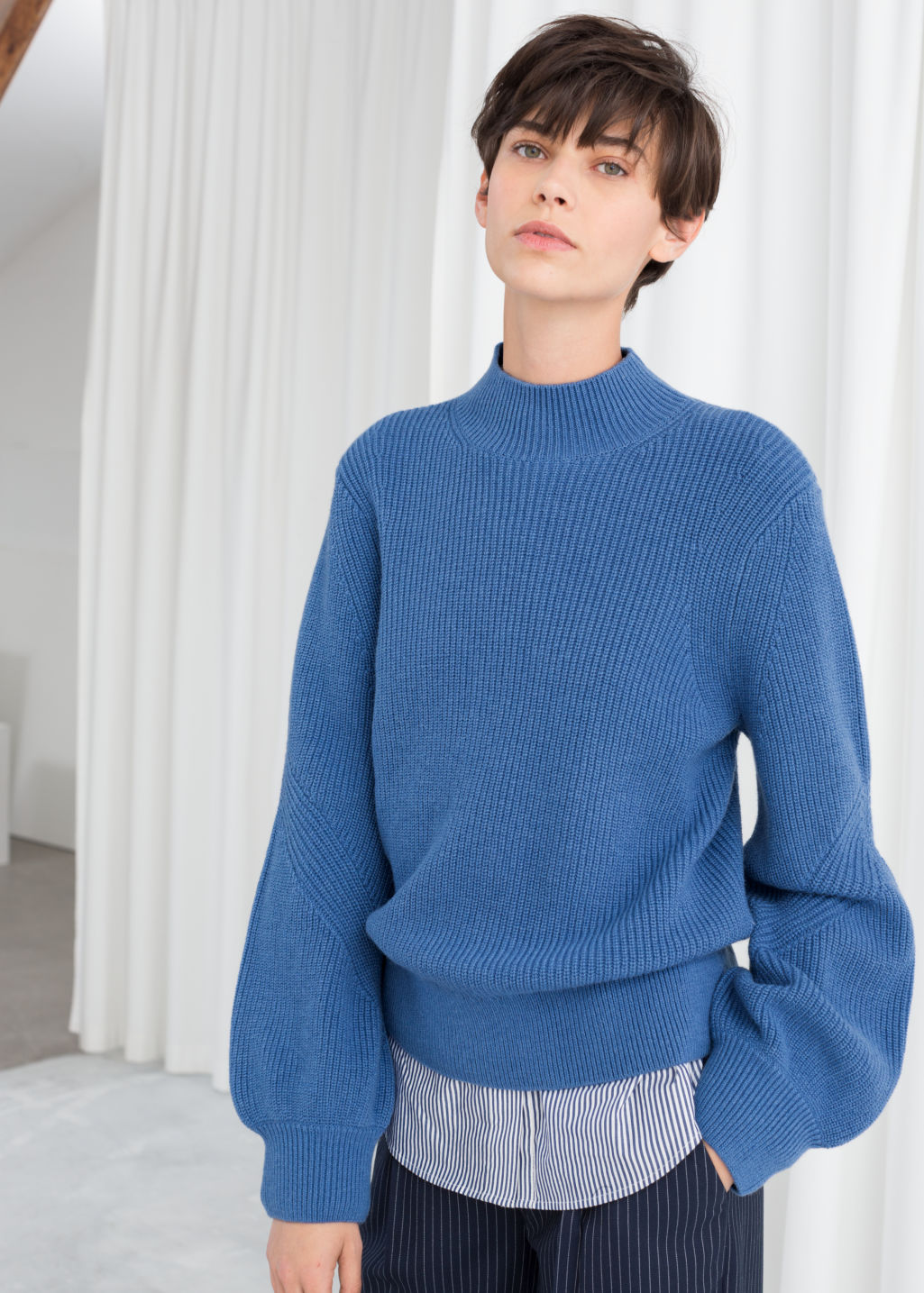 Model front image of Stories balloon sleeve sweater in blue