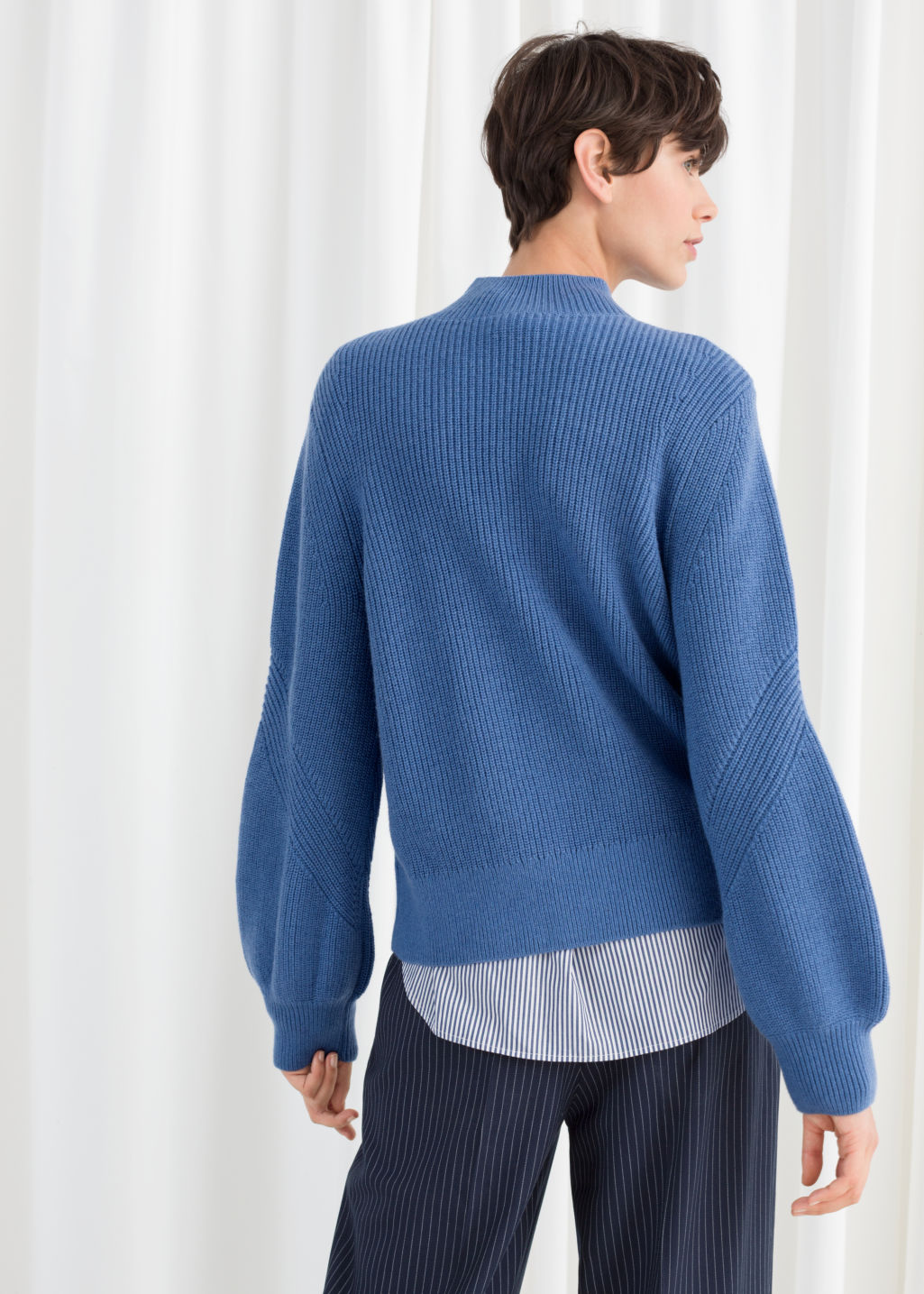 Model back image of Stories balloon sleeve sweater in blue