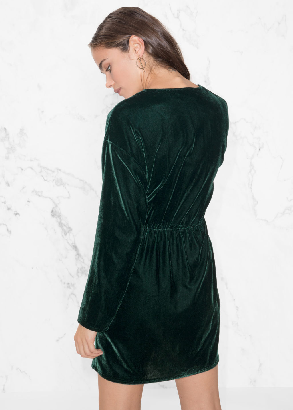 Model back image of Stories velvet dress in green