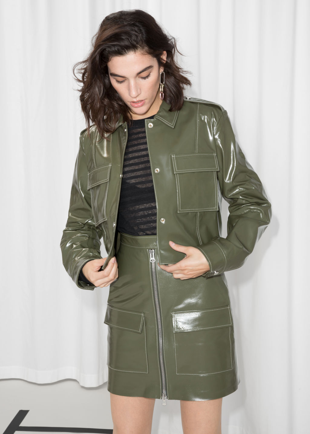Model front image of Stories patent leather utilitarian jacket in green