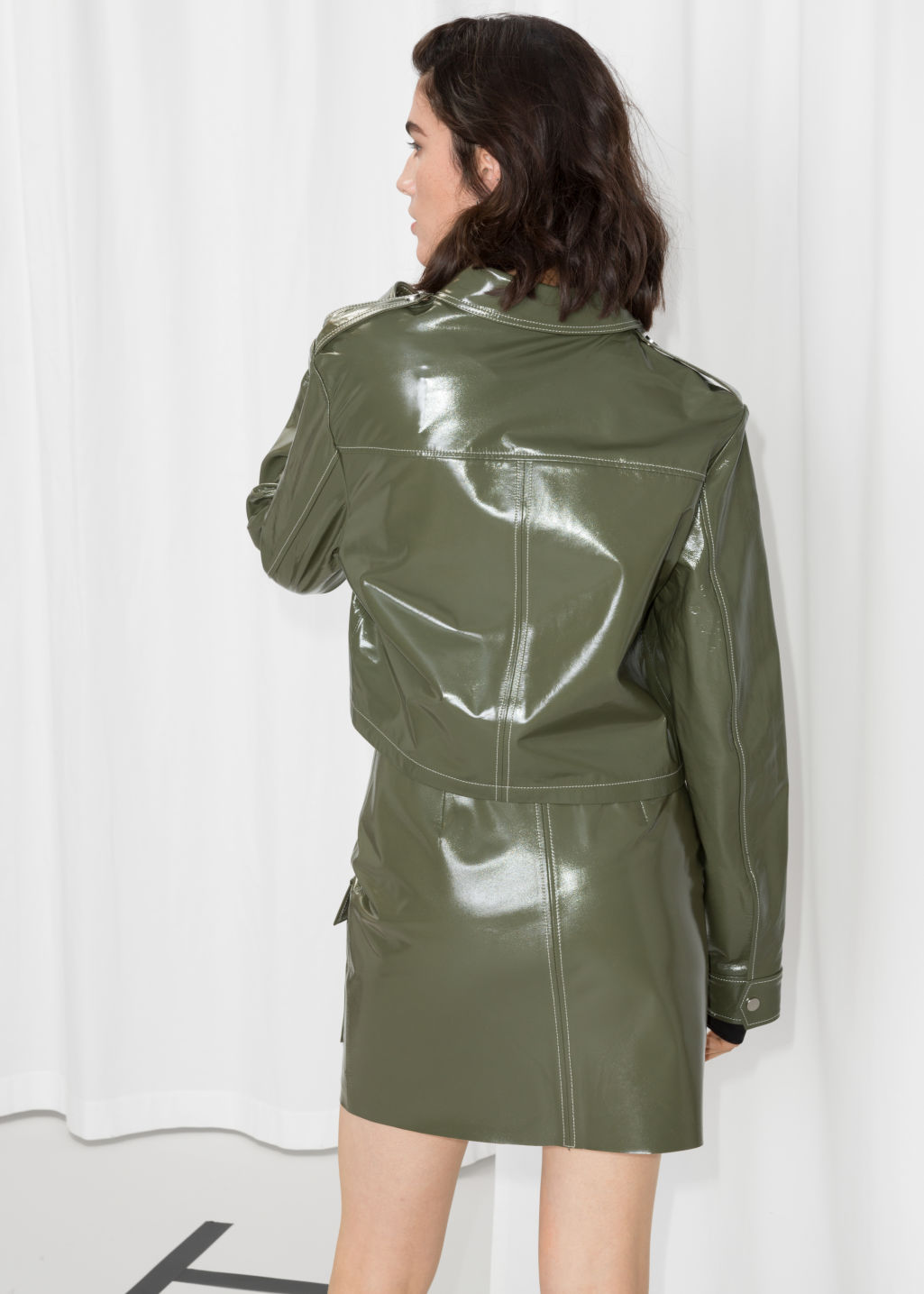 Model back image of Stories patent leather utilitarian jacket in green