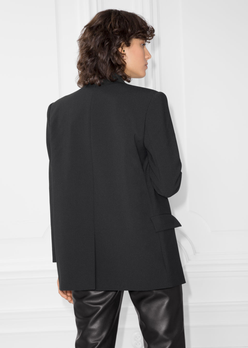 Model back image of Stories double breasted blazer in black