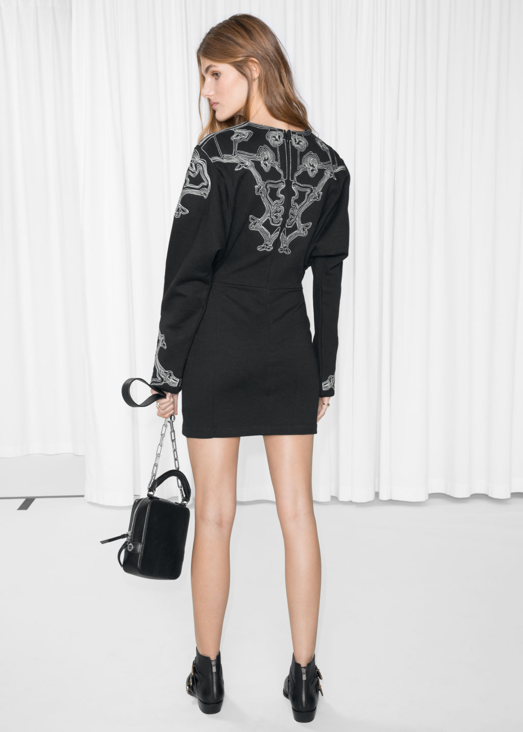 Model back image of Stories embroidered mini dress in black
